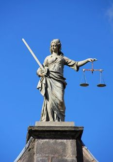 Lady Justice - weighing up the issues with scientism